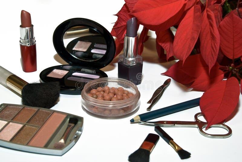 Make-up3. Make up brushes and Assortment of woman's cosmetics - lipstick, eyeshadow, applicator brushes scissor royalty free stock photo