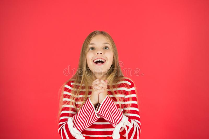 Make a wish. Hope for the best. Girl hopeful excited face making wish. Believe in miracle. Child girl dreaming her wish. Come true. Miracle happens. Little girl stock photos