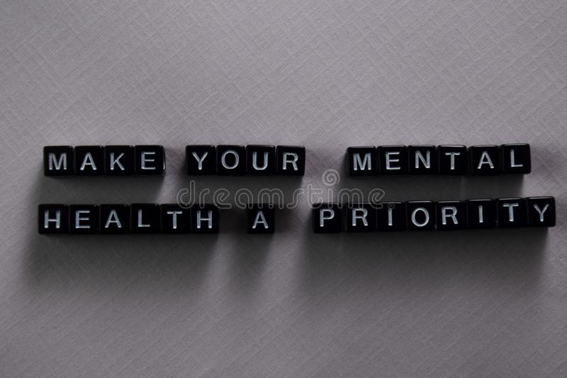 Make your mental health a priority on wooden blocks. Motivation and inspiration concept stock images