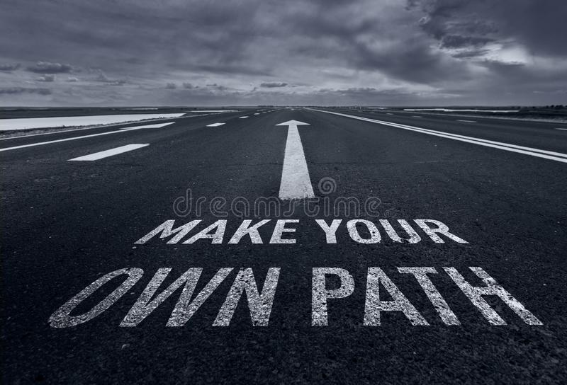 Make your own path. Motivational quote to create future on nature background. stock image