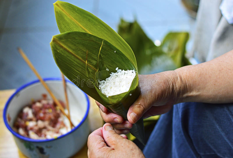 Make Zongzi Traditional Chinese Rice Dumplings for Dragon Boat Festivals royalty free stock photo
