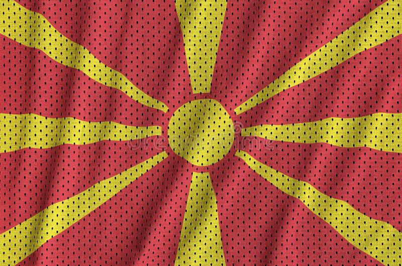 Makedonien flagga som skrivs ut på en fabr för ingrepp för polyesternylonsportswear fotografering för bildbyråer