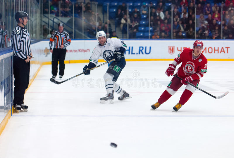 A. Makeev (91) and B. Segal (12). MOSCOW - JANUARY 10: A. Makeev (91) and B. Segal (12) in action on hockey game Vityaz vs Medvezchak on Russian KHL premier royalty free stock photo