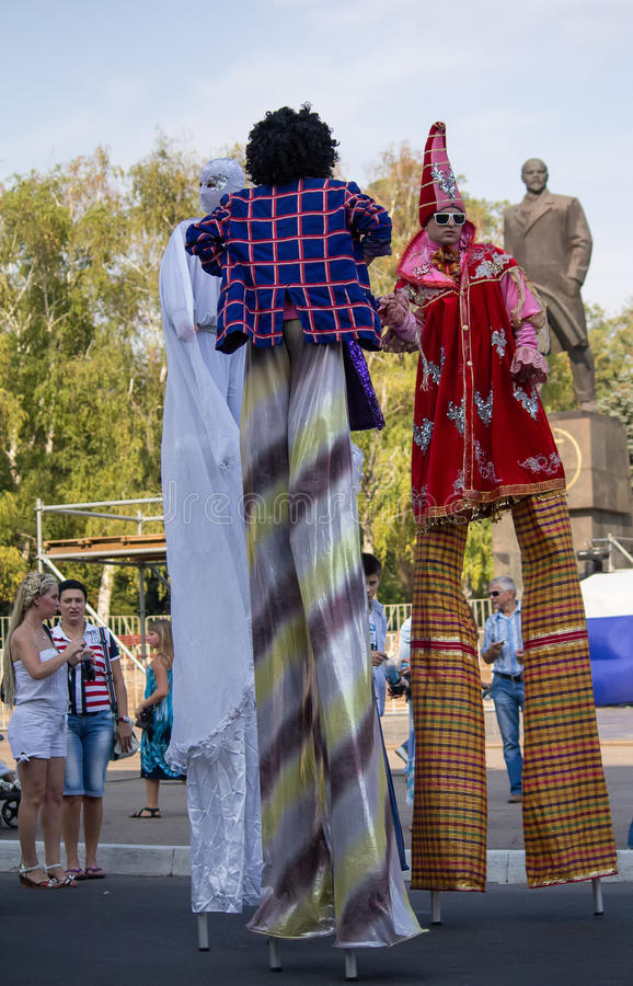 Makeevka, Ukraine - August, 25, 2012: People in costume and on s. Tilts at the celebration of the founding of the city stock image