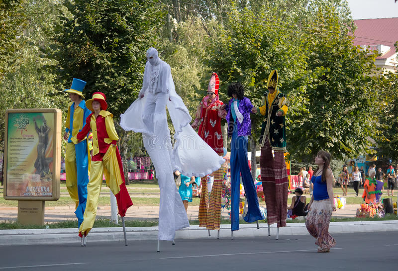 Makeevka, Ukraine - August, 25, 2012: People in costume and on s. Tilts at the celebration of the founding of the city royalty free stock image
