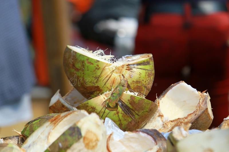 A makeshift stall of coconuts at a street market in Accra, Ghana. A makeshift stall of juicy, raw, fresh, organic coconuts at a street market in Accra, Ghana stock photos