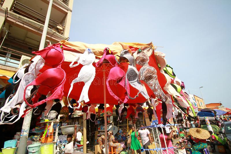 A makeshift stall of bras at a street market in Accra, Ghana. A makeshift stall of colorful secondhand bras flying in the wind at a street market in Accra, Ghana stock photography