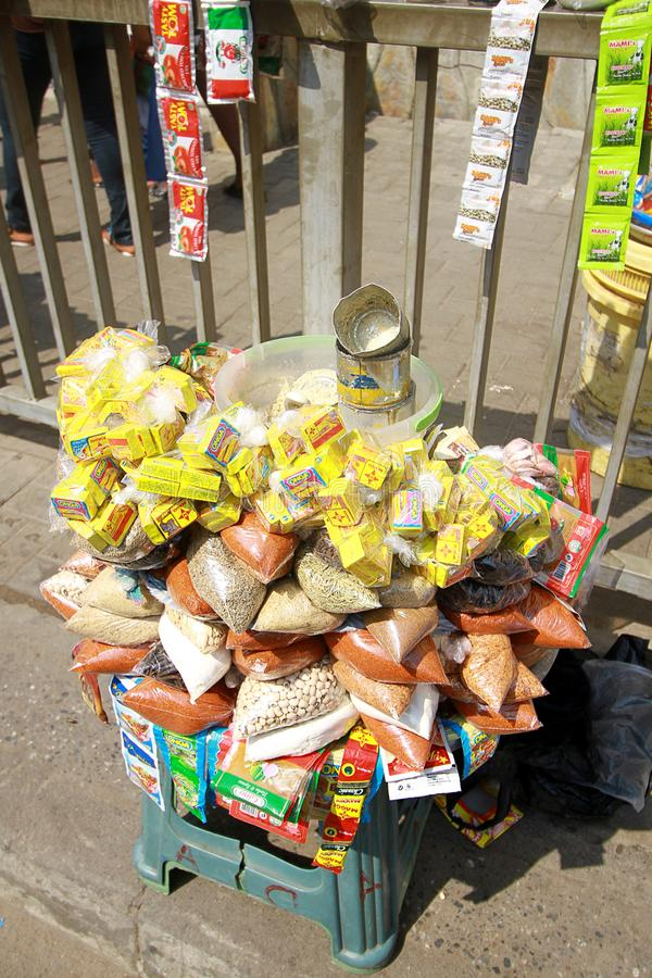 A makeshift stall of local spices at a street market in Accra, Ghana. A makeshift stall of local spices in sachets at a street market in Accra, Ghana stock photos