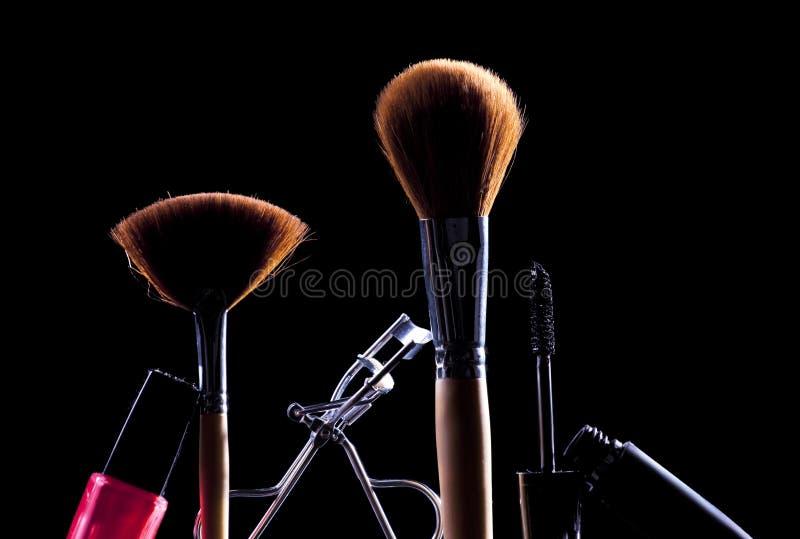 Makeup accessories. Various makeup accessories,brushes , mascara and nail polish royalty free stock photos