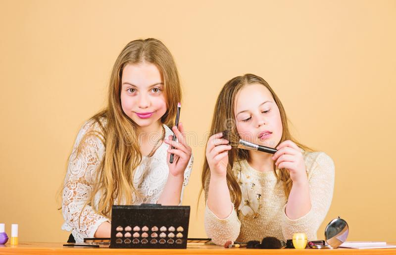 Makeup art. Explore cosmetics bag concept. Salon and beauty treatment. Just like playing with makeup. Makeup courses. Children little girls choose cosmetics stock image