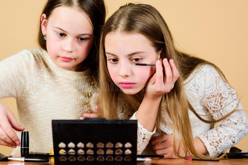 Makeup art. Explore moms cosmetics bag concept. Salon and beauty treatment. Children little girls make up face. Makeup stock images