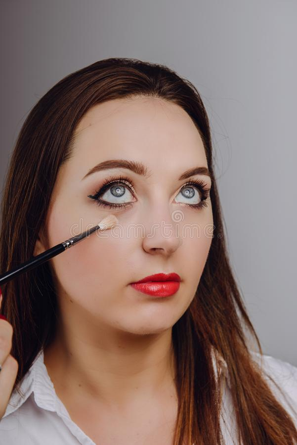 Beautiful woman face. Make up in process royalty free stock images