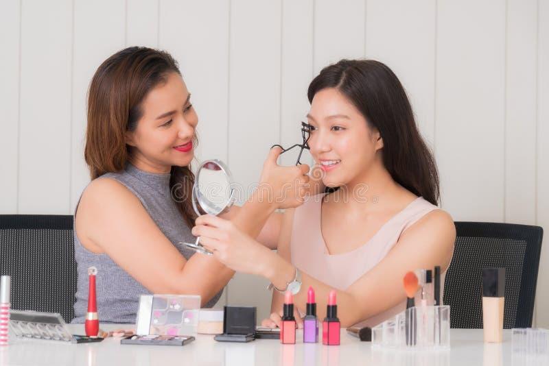 Makeup artist doing makeup beautiful girl stock photo