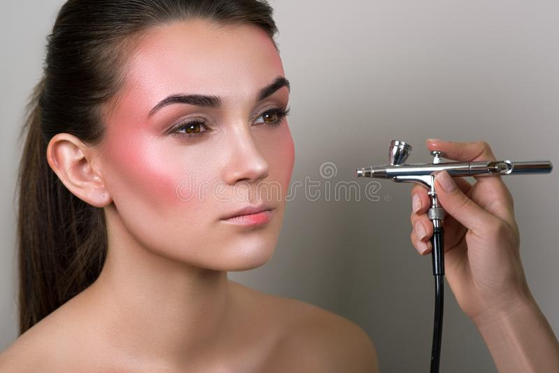 Makeup artist doing professional makeup of young woman. Makeup detail. Beauty girl with perfect skin. Beauty, make-up concept. Por stock image