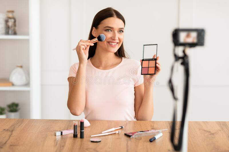 Makeup Artist Girl Making Video For Blog About Cosmetics Indoors. Beauty Blogging Concept. Makeup Artist Girl Making Video For Her Blog About Cosmetics Indoors royalty free stock image