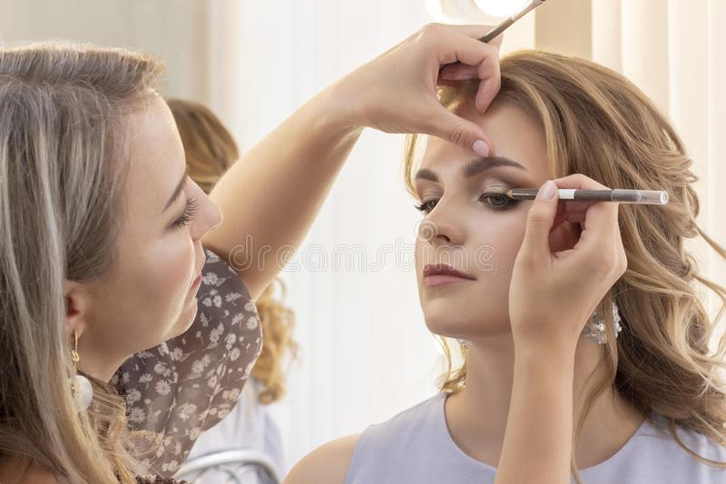 Makeup Artist Puts Make Up On Girl Model Wedding Makeup