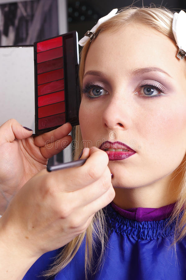 Download Makeup Artist Tracing Red Lipstick On The Lips Stock Photo - Image: 12237974