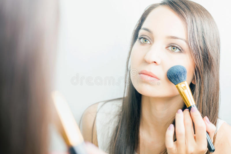 Makeup artist woman doing make up using cosmetic brush for yourself download makeup artist woman doing make up using cosmetic brush for yourself stock image solutioingenieria