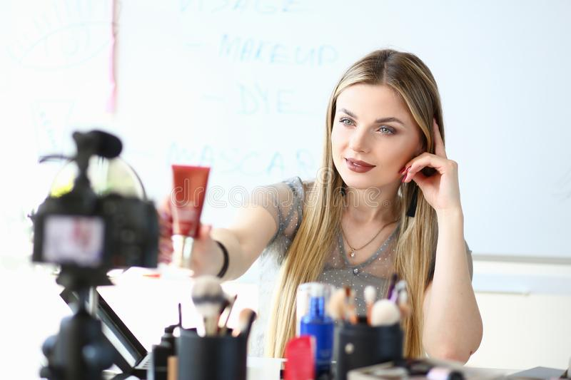 Makeup Artist Work on Beauty Video Blog Review. Beautiful Blond Blogger Recording Skincare Cosmetic Product Promotion. Girl Holding Foundation Sample. Online royalty free stock photos