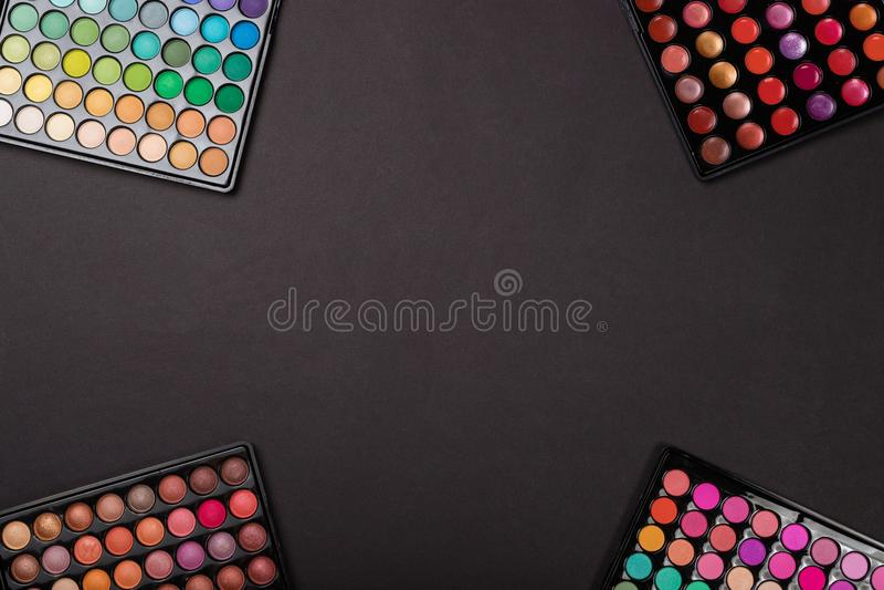 Makeup background of eyeshadow palettes. Makeup background of colorful eyeshadow palettes royalty free stock photo