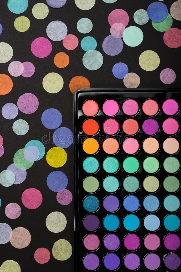 Makeup background made of eyeshadow palette with confetti. Makeup background made of colorful eyeshadow palette with confetti royalty free stock image