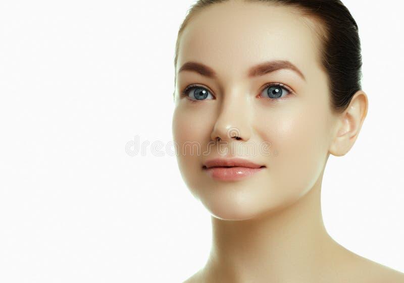 Daily makeup. Beautiful face of a young caucasian woman royalty free stock photos