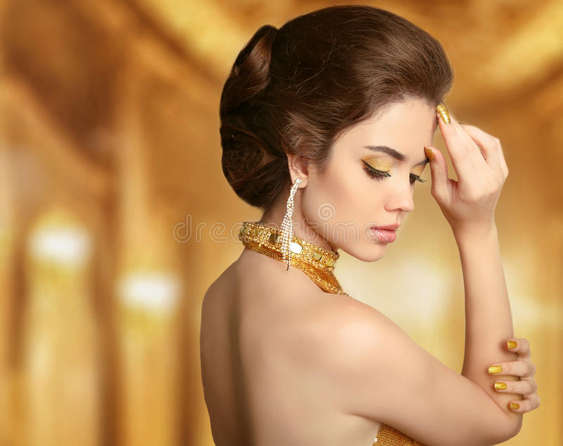 Makeup. Beautiful Fashion Woman In Gold, Elegant Lady In