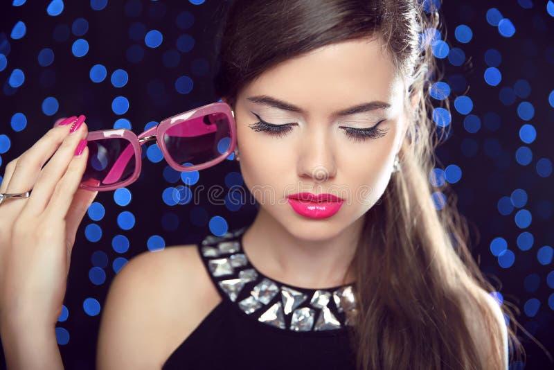 Makeup. Beautiful Girl Model in fashion sunglasses with pink li stock photos
