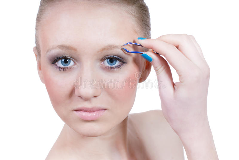 Makeup by beautiful young blond woman isolated stock image