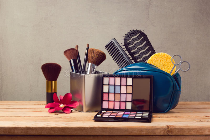 Makeup and beauty products on wooden table royalty free stock image