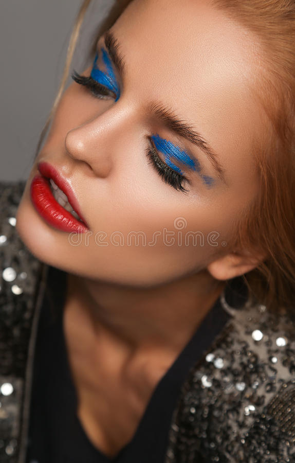 Makeup and beauty theme: beautiful girl with red lips and blue eyes in studio. Makeup and beauty theme: beautiful girl with red lips and blue eyes stock photos