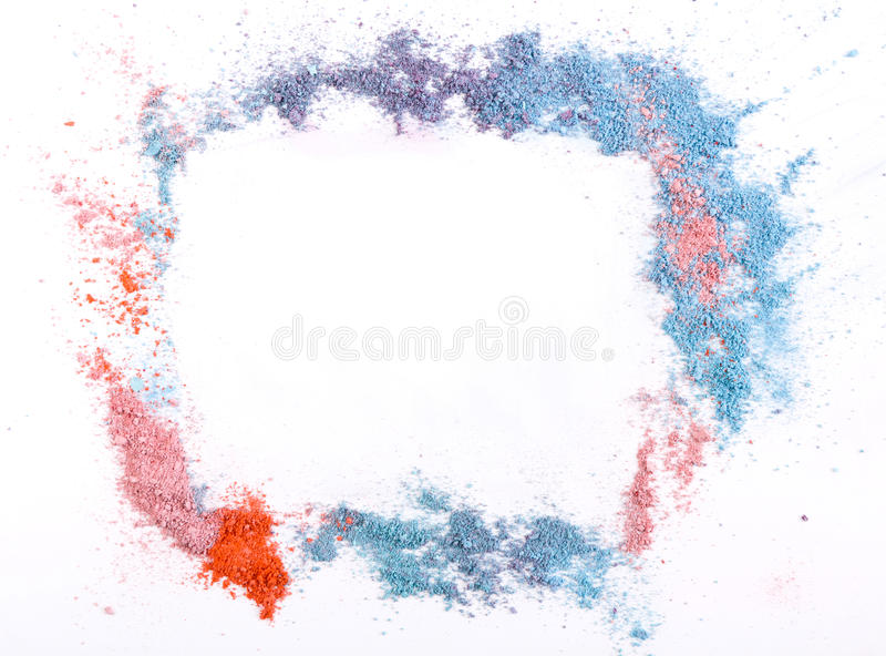 Makeup blush or eyeshadow of pink, blue and coral tones sprinkled on white background stock photo