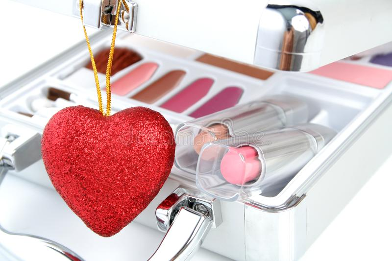 Makeup briefcase and heart stock image