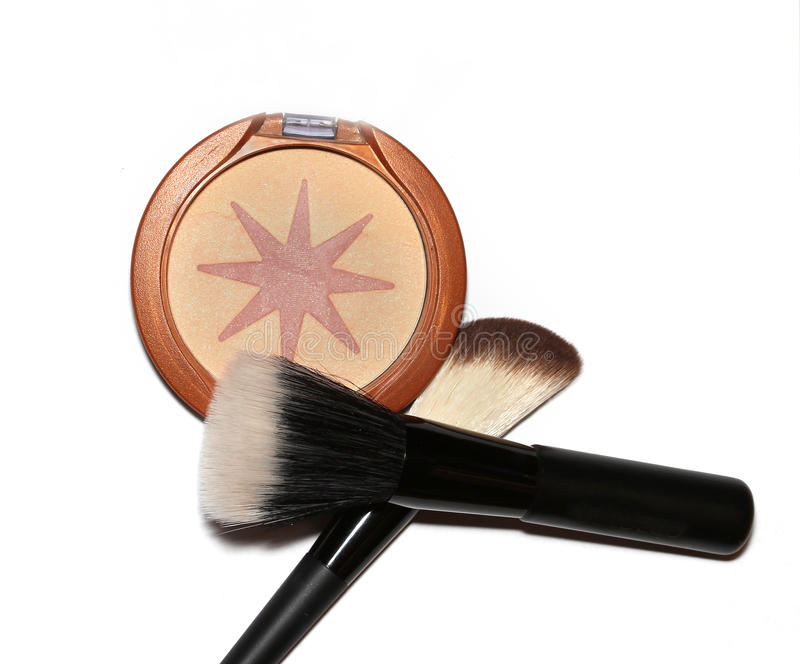 Makeup bronzer. Facial make up bronzer with applicator brushes royalty free stock images