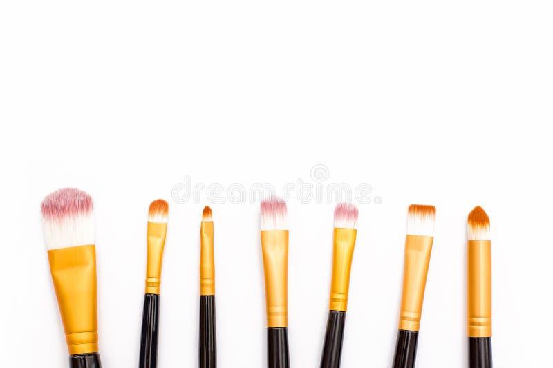 Makeup brush lying casually on white background royalty free stock image