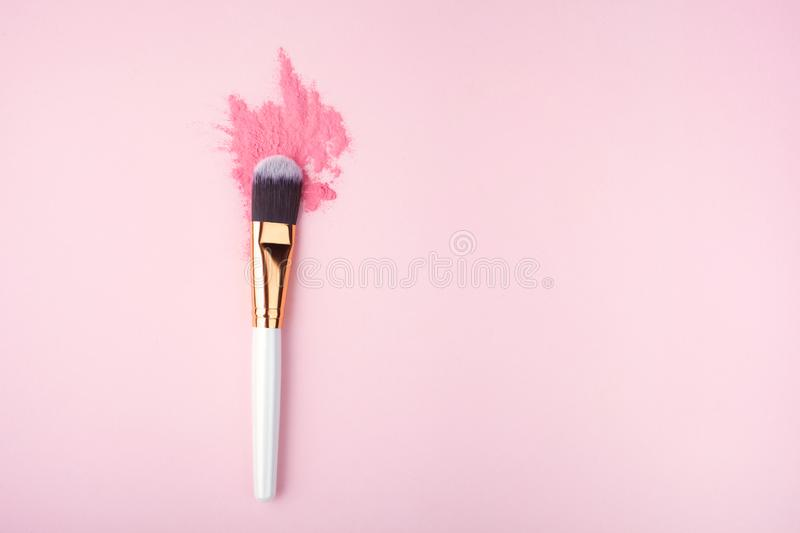 Makeup Brush on pink Background with Colorful Pigment Powder. Top view. Makeup Brush on pink Background with Colorful Pigment Powder royalty free stock photography