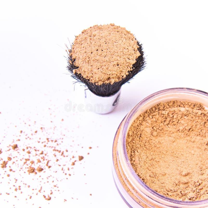 Makeup brush and powder royalty free stock photography