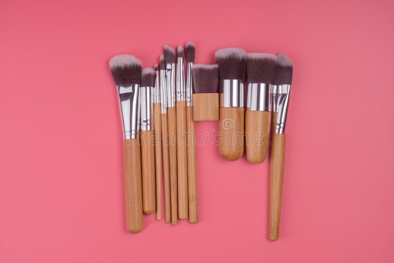 Makeup brush set on red pink pastel background royalty free stock image