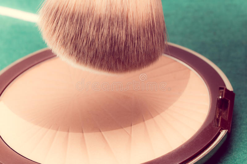 Makeup brush, vintage style stock photos