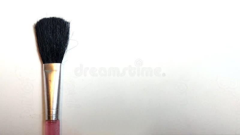 Makeup brush on white background royalty free stock photo
