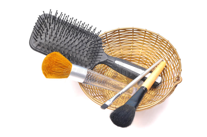 Makeup brushes and comb. In basket isolated on white background stock images
