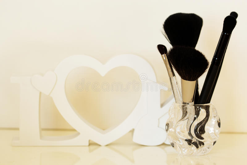 Makeup brushes on a dressing table, close-up. Dressing table with makeup brushes on a table, close-up stock photo
