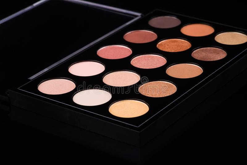 Makeup brushes and make-up eye shadows royalty free stock photography