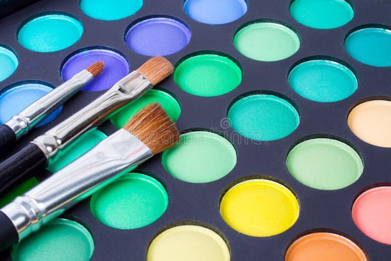 Makeup brushes and make-up eye shadows stock image