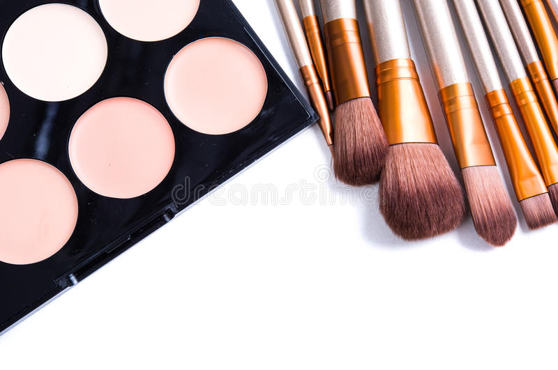 Makeup brushes set and foundation cream isolated. Makeup brushes set and foundation cream palette, beauty professional tools isolated on white background stock photography