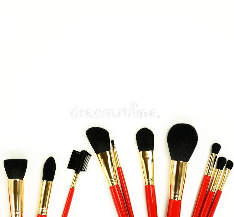 Makeup brushes set in red color on white background. Professional makeup tools stock image