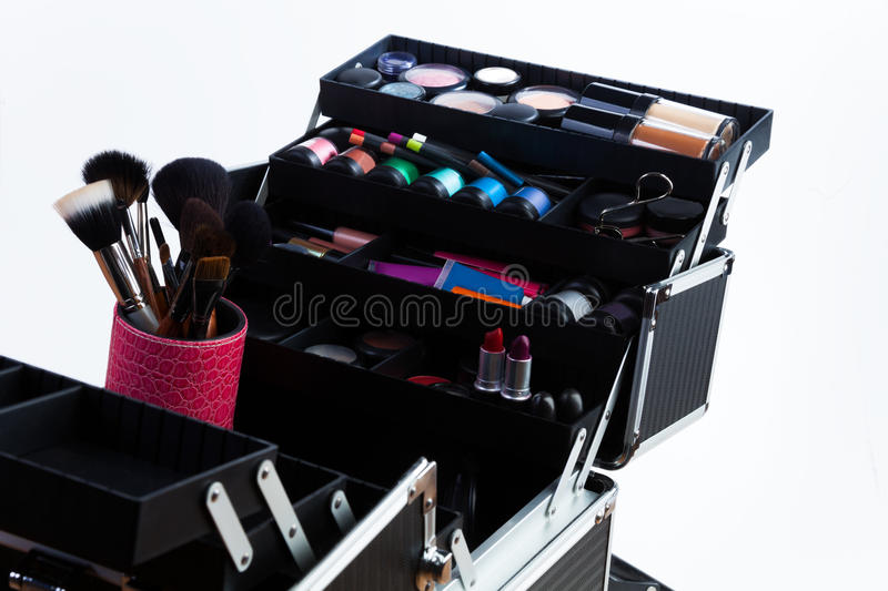 Makeup brushes and tools. Large professional makeup container with containers tubes lipsticks eyeshades and makeup brushes stock image