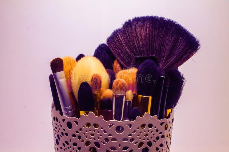 Makeup brushes in vase royalty free stock images