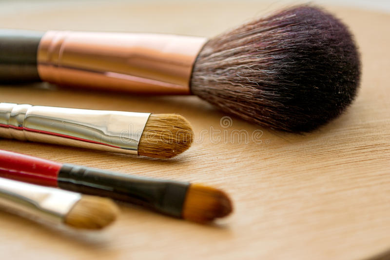 Makeup brushes on a wooden background stock photos