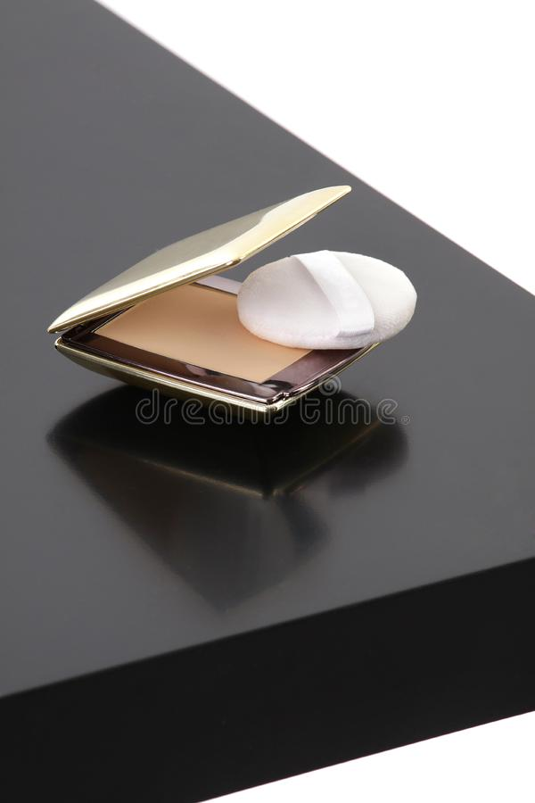Makeup compact powder on black table stock images